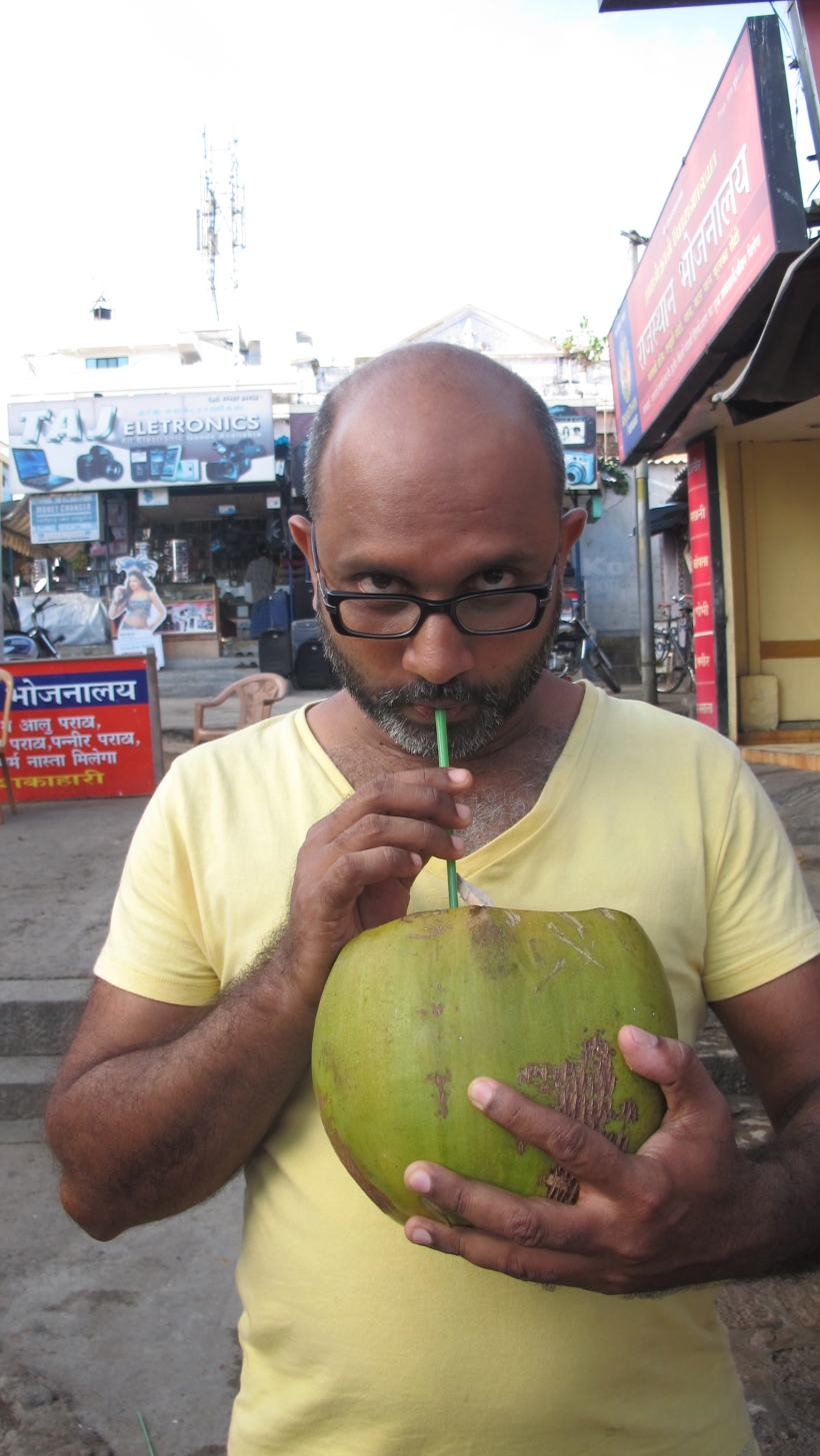 Master Mahesh and his coconut.